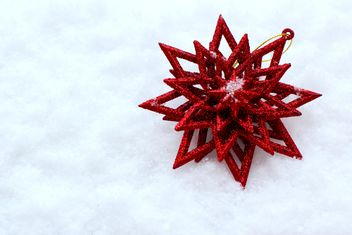 Red Christmas decoration on snow - бесплатный image #182627