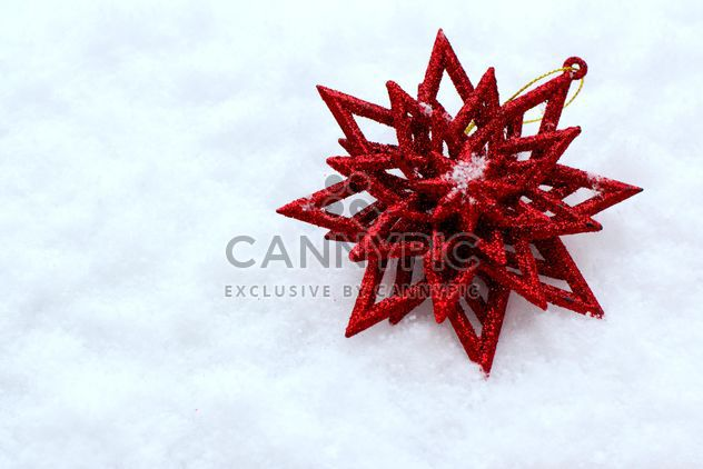 Red Christmas decoration on snow - Free image #182627