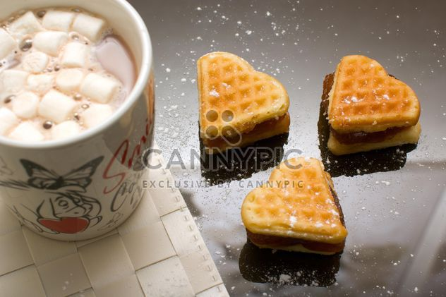 Sweet breakfast, heart shaped waffles and cocoa with marshmallows - image #182667 gratis
