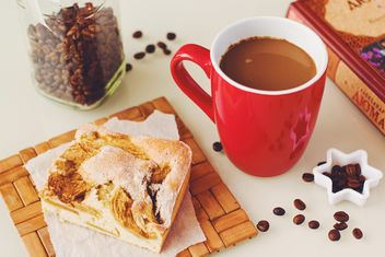Cup of coffee, piece of pie, coffee beans and book - бесплатный image #182747