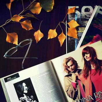 Open magazine, glasses and yellow leaves - image #182767 gratis