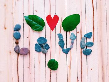 Word Love made of stones on wooden background - бесплатный image #184107