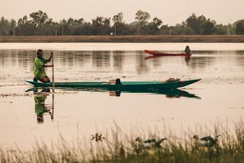 Fishermen in boats on water - image #186077 gratis
