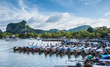 Wooden boats moored on a pier - бесплатный image #186297