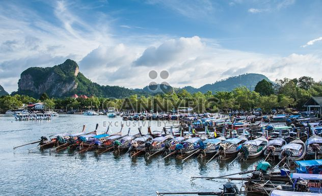 Wooden boats moored on a pier - image #186297 gratis
