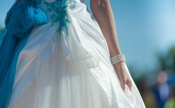 bride holding wedding dress gown - Free image #186317