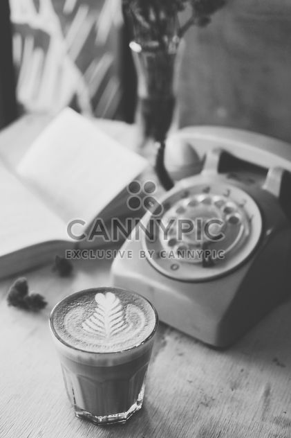 Coffee latte art and old phone - бесплатный image #187117