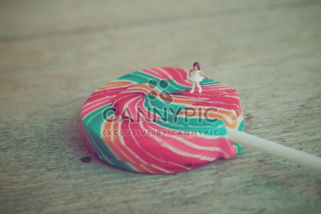 Miniature girl on colorful lollipop - Free image #187127
