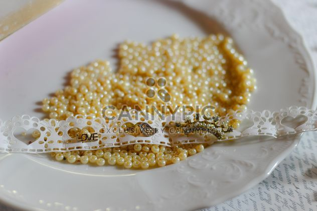 Yellow beads on plate - бесплатный image #187277