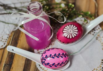 Easter eggs and bottle of pink liquid - image #187447 gratis