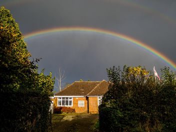 Landscape with rainbow over house - image #198237 gratis