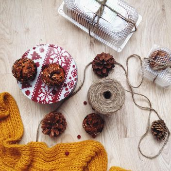 Christmas muffins, rope and knitted scarf - image #198427 gratis