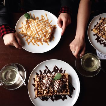 Belgian waffles with banana, ice-cream and chocolate - image #198457 gratis