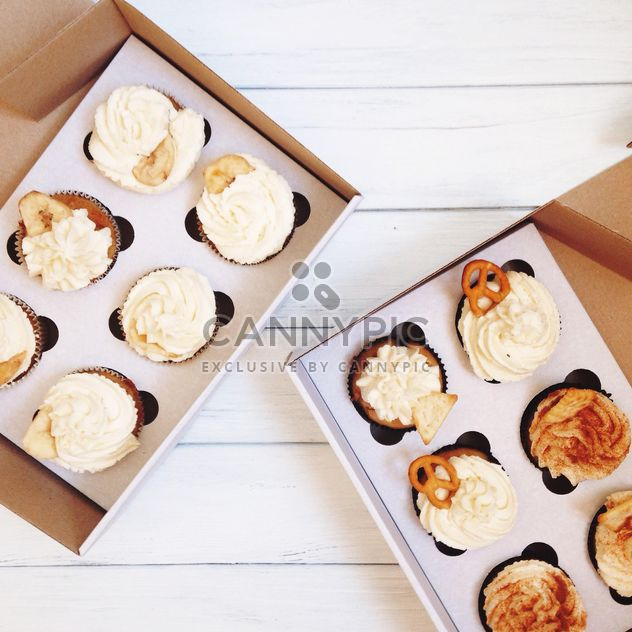 Cupcakes in boxes on white background - Free image #198537