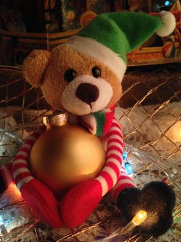Cute soft teddy bear with a Christmas ball - image #198807 gratis