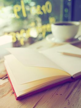Notebook and coffee cup - Kostenloses image #201147