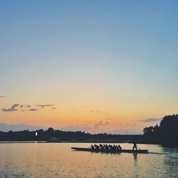 Men rowing at sunset - Free image #271717