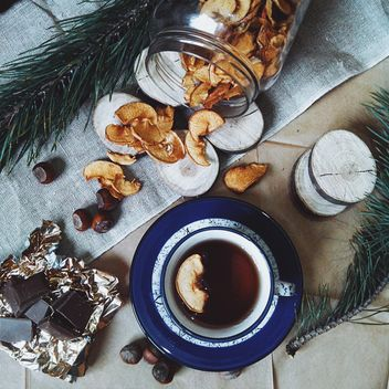Cup of tea, dried apples and chocolate - бесплатный image #272247