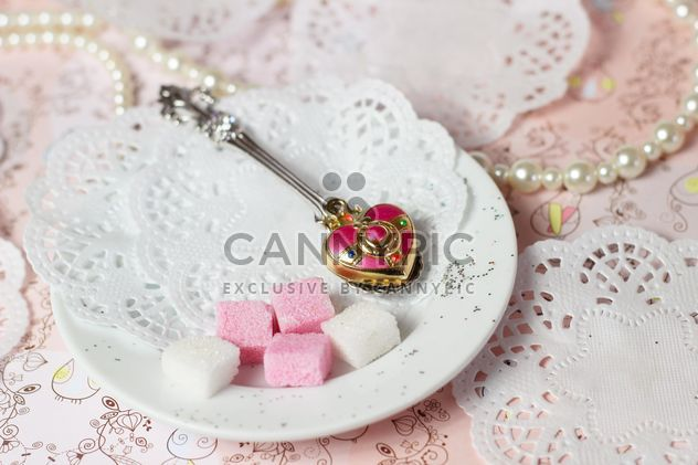 Pink and white sugar on a plate - Free image #272997