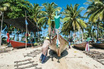 Fishing boats on a beach - Free image #273547
