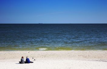 Couple sittting on sandy beach - Free image #303347