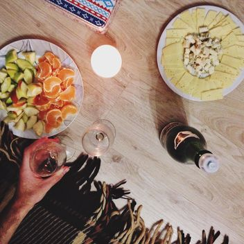 warm evening with wine, cheese and fruits - image gratuit #304027