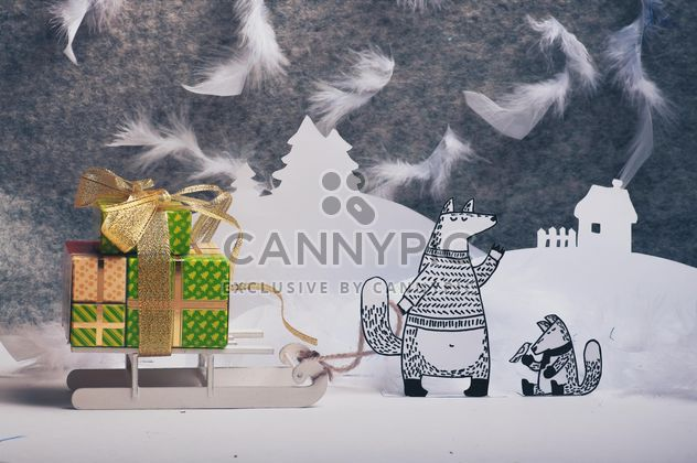 Paper cut foxes with gifts on sledge in winter - Free image #327307