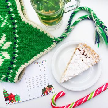 tea with mint and cake near the green hat and a letter to Santa Claus - image #329197 gratis
