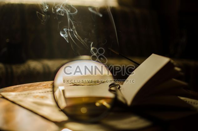 Autumn yellow leaves through a magnifying glass with incense sticks and book - Free image #330407