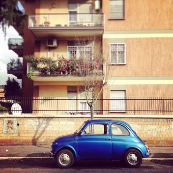 Blue Fiat 500 parked near the house in Rome, Italy - Free image #331817