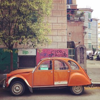 Old orange car in the street - image #331877 gratis