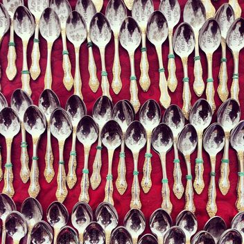 Souvenir spoons on red background - бесплатный image #332087