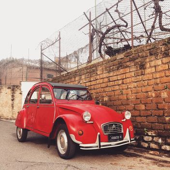 Red Citroen near brick wall - image #332317 gratis