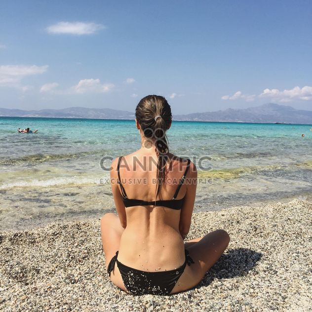 Young woman on seashore - Free image #332377