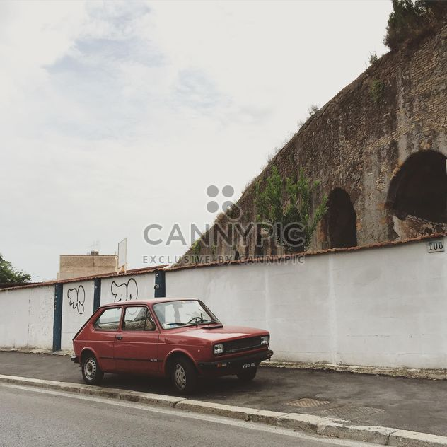 Old Fiat car parked near ancient arch - Free image #332397