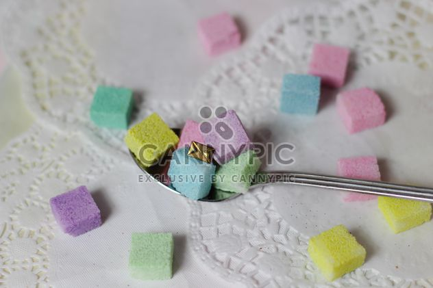 of Colorful Refined sugarcubes on a spoon - image #333567 gratis
