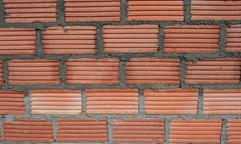Red brick wall - image #338257 gratis