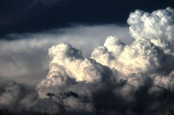 Fluffy clouds in sky - Free image #338277