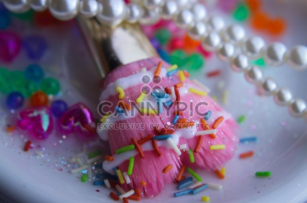 Pink makeup brush and pearls on a plate - Free image #341477