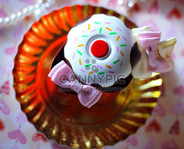 Cupcake decorated with ribbons - Free image #341517