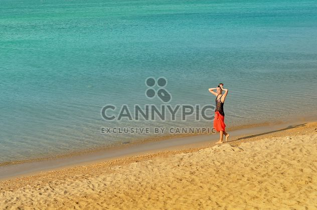 Girl walking down the coastline - Free image #344037