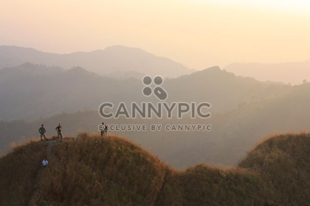 Group of tourists in mountains at sunset - Free image #344577