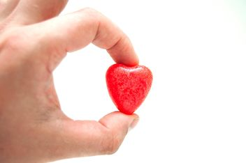 Decorative heart in hand on white background - бесплатный image #345907
