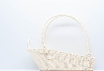 White wicker basket on white background - image gratuit #347237