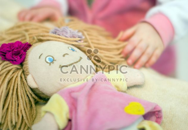 Closeup of baby doll and girl on background - image gratuit #347927