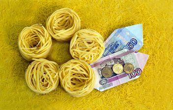 Italian tagliatelle nest and money on yellow background - image gratuit #347947