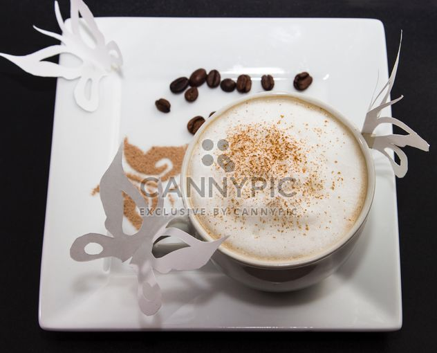 coffee in a white cup with a thick foam of milk and cinnamon - Free image #350287