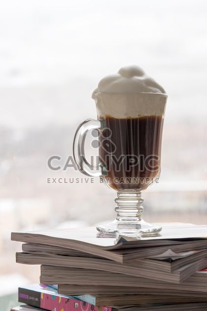 Cup of coffee on pile of magazines - Free image #350307
