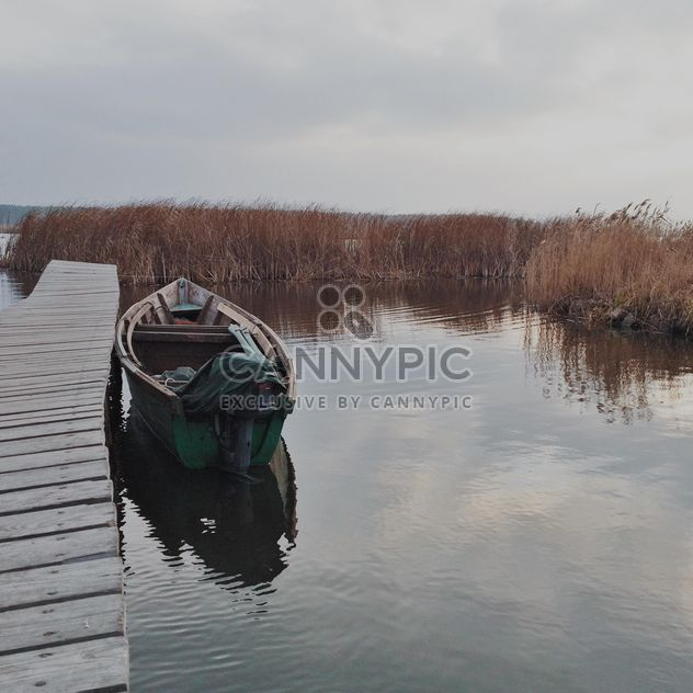 Landscape with boat on lake - image #363667 gratis