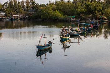 fishing boats in canal near the sea - Free image #439047